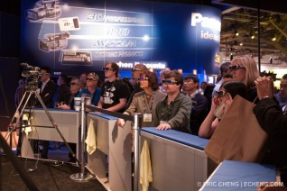 A crowd gathers around a demonstration of the new Panasonic 3D camcorder. It's hard to look cool in these glasses, eh?
