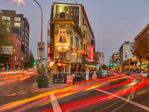 Traffic zooms by at the intersection of Stark and Burnside in the pearl District of downtown Portland, Oregon, USA.